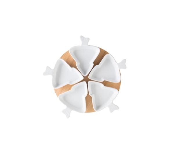 6 em 1 | Elementos iguais espalhados pela mesa tornam-na mais uniforme e composta. | Prato Continente Kasa, 15€