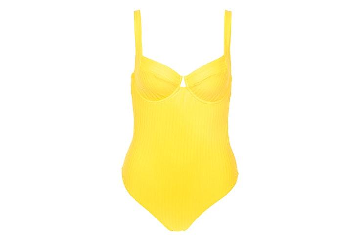 Bañador liso en color amarillo con varillas de Calzedonia