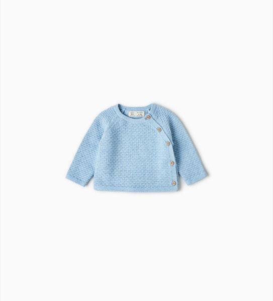 Camisola recém-nascido, antes era a 12,95€ e agora é a 9,99€, na Zara Kids