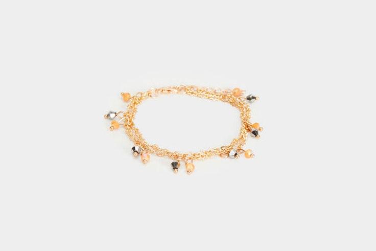 pulsera-dorada-detalle-perlas-parfois