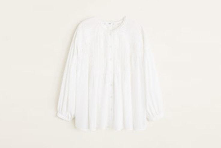 Blusa blanca con mangas abotonadas de Mango