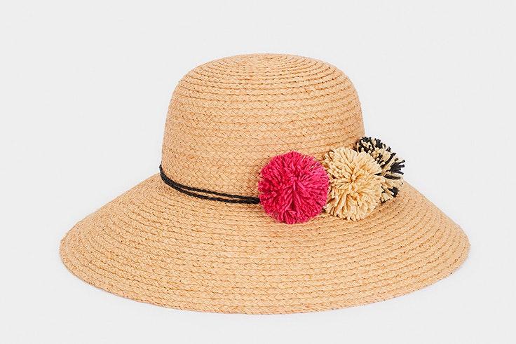 Sombrero de rafia con pompones de colores de Parfois - 22.99€