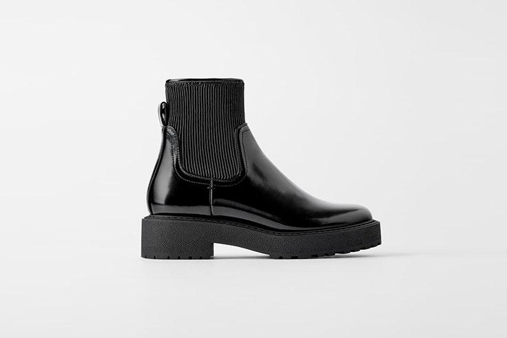 botín negro plano caña alta plisada zara